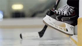 Little Hockey Skate Stepping On Ice
